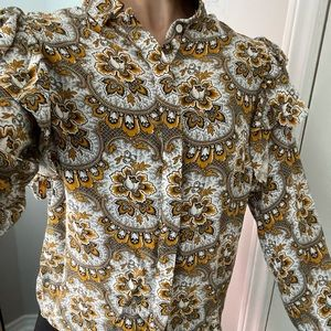 Floral pattern blouse with cute fluff on shoulders
